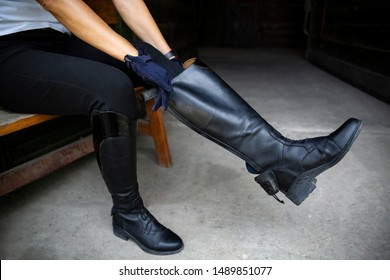 Horse riding. Leather equestrian boots. Riding clothes.