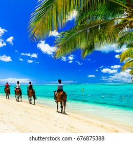Horse riding on tropical beach. Mauritius island