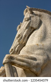 Horse sculpture as adetail from the garden of Jeronimos monastery in Belem,