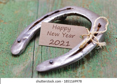 horse shoe with greetings for new year 2021