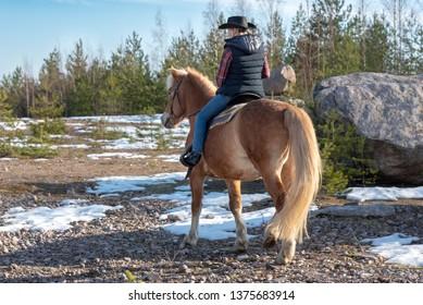 Horseback riding in forest