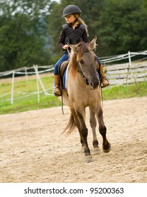 Horseback riding - lovely girl is riding a horse