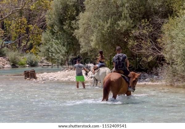 A horseback riding near the Acherontas river on a sunny, summer day (Epirus, Greece).