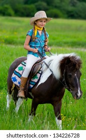 Horseback riding - young girl is riding a pony