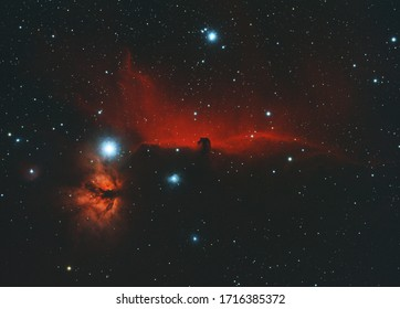 Horsehead and Flame nebula in Orion constellation, taken in the dark space with stars at background.