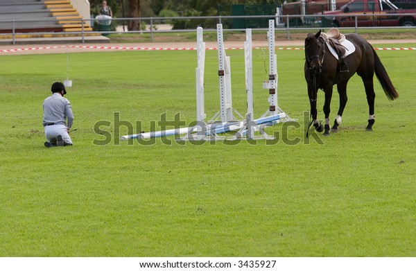 A horseman is down after the horse refused to take the jump