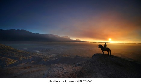 Horsemen in beautiful sunrise