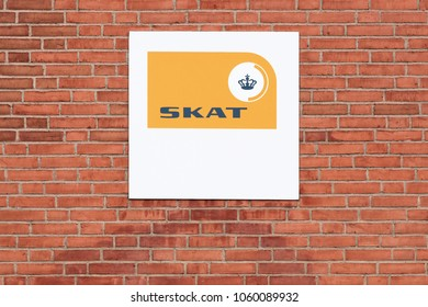 Horsens, Denmark - April 1, 2018: Danish tax authority logo on a wall called Skat in Danish. It is the state authority under which the Danish Treasury calculates and collects taxes and levies charges