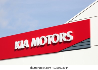 Horsens, Denmark - April 1, 2018: Kia Motors logo on a wall of a dealership. Kia Motors Corporation headquartered in Seoul, is South Korea's second largest automobile manufacturer