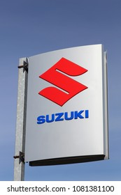 Horsens, Denmark - April 2, 2018: Suzuki logo on a panel. Suzuki is a Japanese multinational corporation which specializes in manufacturing automobiles, 4 wheel drive vehicles and motorcycles