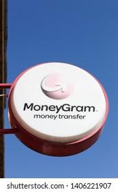 Horsens, Denmark - April 2, 2018: MoneyGram logo on a wall. MoneyGram International Inc. is a money transfer company based in the United States with headquarters in Dallas, Texas