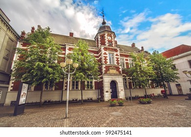 HORSENS, DENMARK - JUNE 11: Town Hall with the emblem of the city on the tower, in the center of Horsens, Denmark
