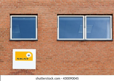 Horsens, Denmark - May 22, 2016: Danish tax authority offices called Skat in Danish. It is the state authority under which the Danish Treasury calculates and collects taxes and levies charges