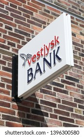 Horsens, Denmark - May 5, 2019: Vestjysk Bank logo on a wall. Vestjysk Bank is the 9th largest Danish bank with headquarters in Lemvig