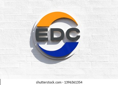 Horsens, Denmark - May 5, 2019: EDC logo on a wall. EDC is Denmark's largest and oldest real estate chain formed in 1971 with 232 independent real estate agencies