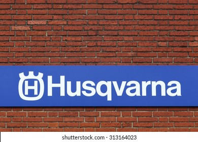 Horsens, Denmark - September 3, 2015: Husqvarna logo on a facade. Husqvarna is swedish a manufacturer of robotic mowers, garden tractors, chainsaws, trimmers, bicycles and motorcycles.