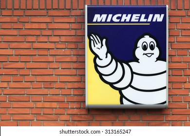 Horsens, Denmark - September 3, 2015: Michelin logo on a facade. Michelin is a tire manufacturer based in Clermont-Ferrand in France and it is one of the three largest tire manufacturers in the world