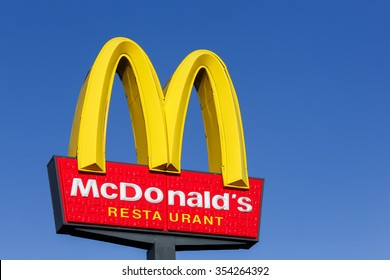 Horsens, Denmark - September 30, 2015: McDonald's logo on a pole. McDonald's is the world's largest chain of hamburger fast food restaurants