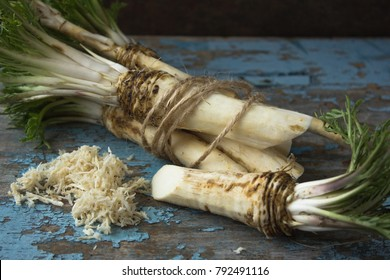 horseradish on a wooden table