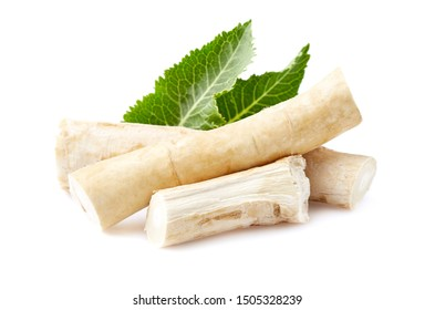 Horseradish root with leaves on white background
