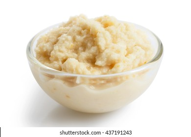 Horseradish sauce in small glass bowl in perspective on white.