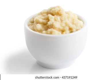 Horseradish sauce in small white bowl in perspective on white.