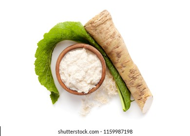 Horseradish in wooden bowl isolated on white background from above.