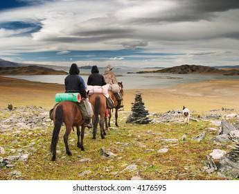 Horseriders in mongolian wilderness