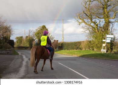 Horse-riding road saftey, a young woman taking her road saftey seriously.