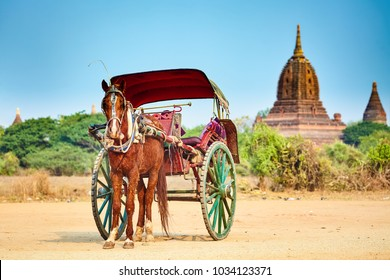 Horses cart waiting for tourist, ancient temple on background. Bagan,Myanmar