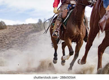 Horses and Cowboy riding hard; up close viewpoint; no recognizable faces