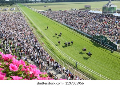 Horses finish a race down the home straight in front of a packed Clock Tower enclosure and stands at York Races : The Knavesmire, York Racecourse, Nth Yorkshire, UK : 14 July 2018 : Pic Mick Atkins