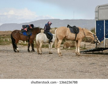 Horses and riders prepare for a gallop on Red Wharf Bay, Isle of Anglesey, North Wales, United Kingdom, Europe during a sudden hailstorm, Tuesday, 2nd, April, 209