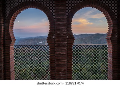 Horseshoe arch window at Comares village. Pueblo blanco up on the hill of Malaga mountains, Andalusia, Spain
