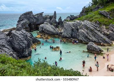 HORSESHOE BAY, BERMUDA - MAY 26 - People enjoying a rock enclosed swimming cove at Horseshoe Bay on May 26 2016 in Bermuda.
