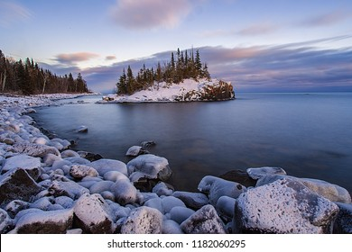 Horseshoe Bay island covered ing winters snow on the Lake Superior shoreline in Minnesota.