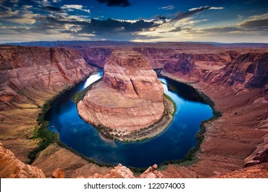 Horseshoe Bend, canyon and Colorado river at sunset.