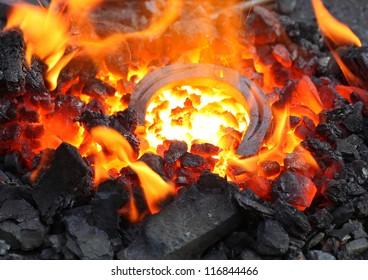 horseshoe in embers in forge