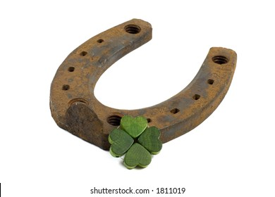 horseshoe and four-leave clover isolated on white background