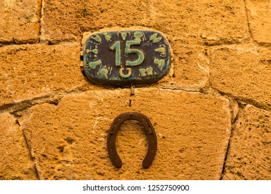 Horseshoe on the wall with number fifteen