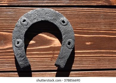 horseshoe on weathered wood
