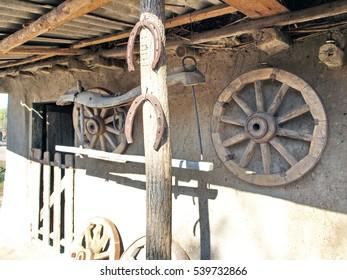 horseshoes, a wooden wheel. Ukrainian hut