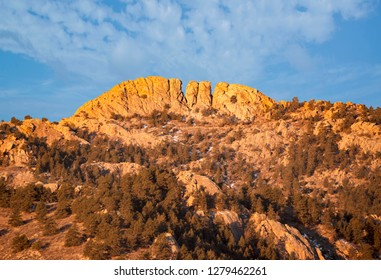 Horsetooth rock formation  at sunrise is a distinctive geological and popular mountain landmark overlooking Fort Collins, Colorado