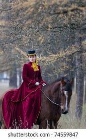 Horsewoman in vintage stylized suit.