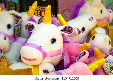 Horsham, England - May 5 2018: Soft Toy Unicorns with Golden Horns.  Summer Fun in the Sun