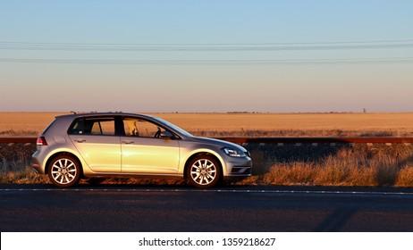 Horsham, Victoria/Australia, 02.23.19 VW Golf taken in sunset on lonely road