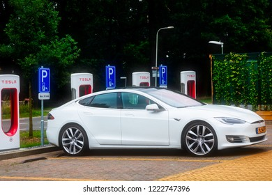 Horst, Netherlands - June 25, 2018: Tesla Super Charging station on Horst .Tesla Supercharger stations allow Tesla cars to be fast-charged at the network within an 30 min