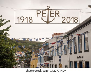 Horta, Faial / Azores - August 23, 2018: Sign celebrating 100 years of Peter Cafe Sport, a bar and restaurant famous for being the first to open in the Azores in 1918.