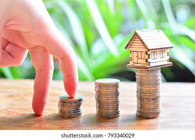 hose model set on coins saving for concept investment mortgage finance and home loan