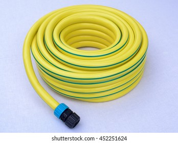 Hose-pipe with coupling on a white background